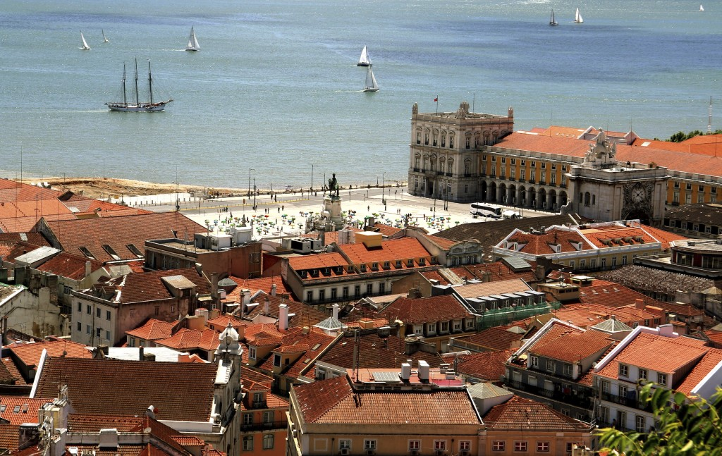Bird way of central Lisbon with red roofs and river embankment
