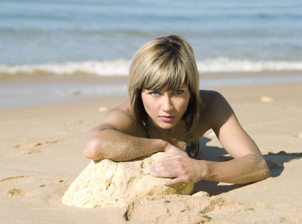 Fiery woman on the beach