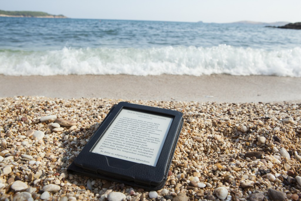 E-Reader on Beach - iStock_000045867596_Medium