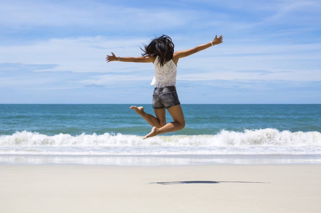 jumping on beach iStock_000068697271_Medium