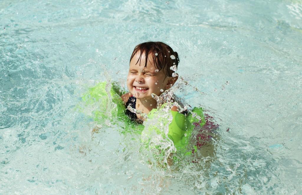 little girl swimming in pool - iStock_000047861044_Large