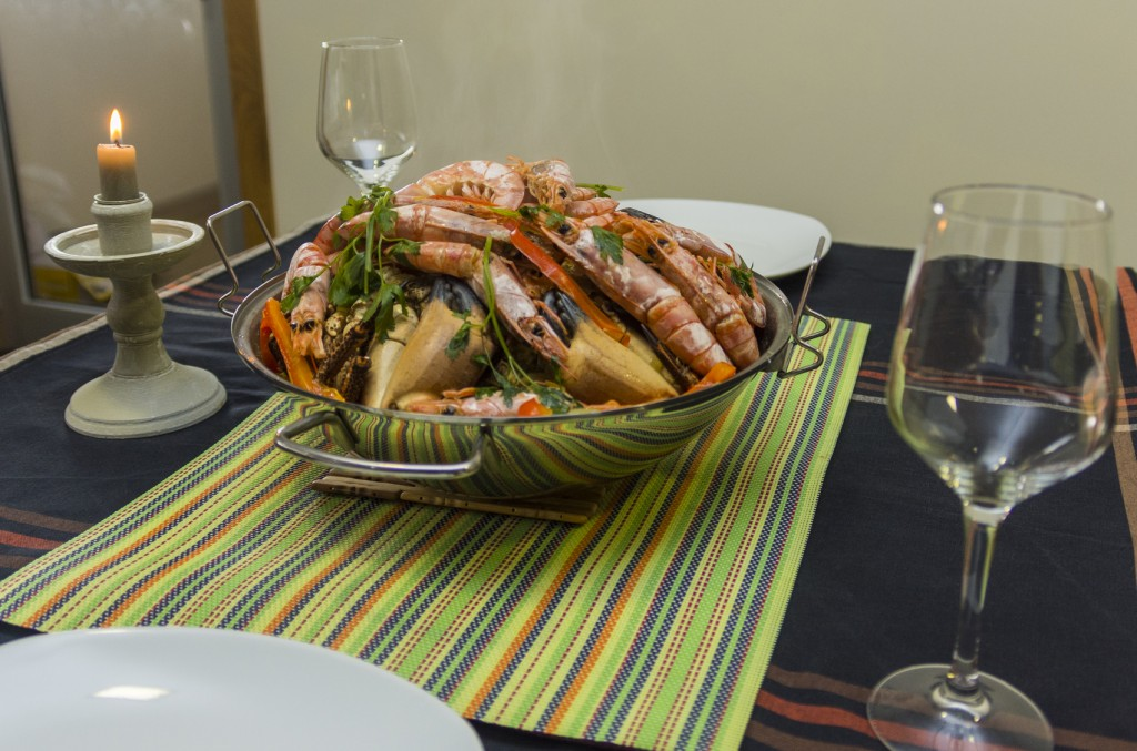 cataplana seafood served with white wine