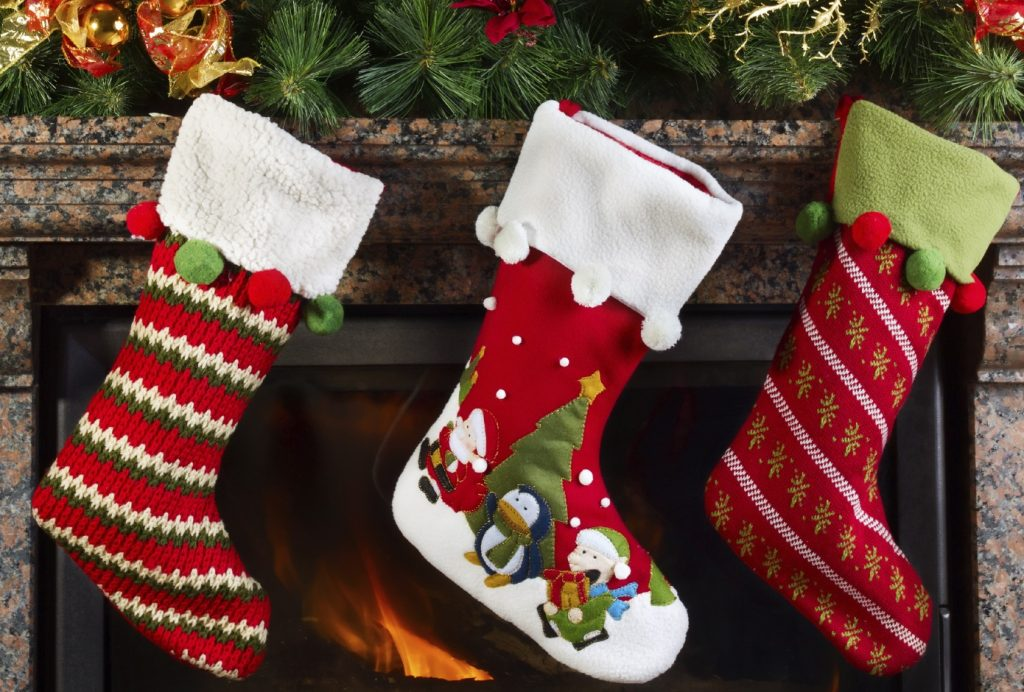 Christmas stocking on fireplace background