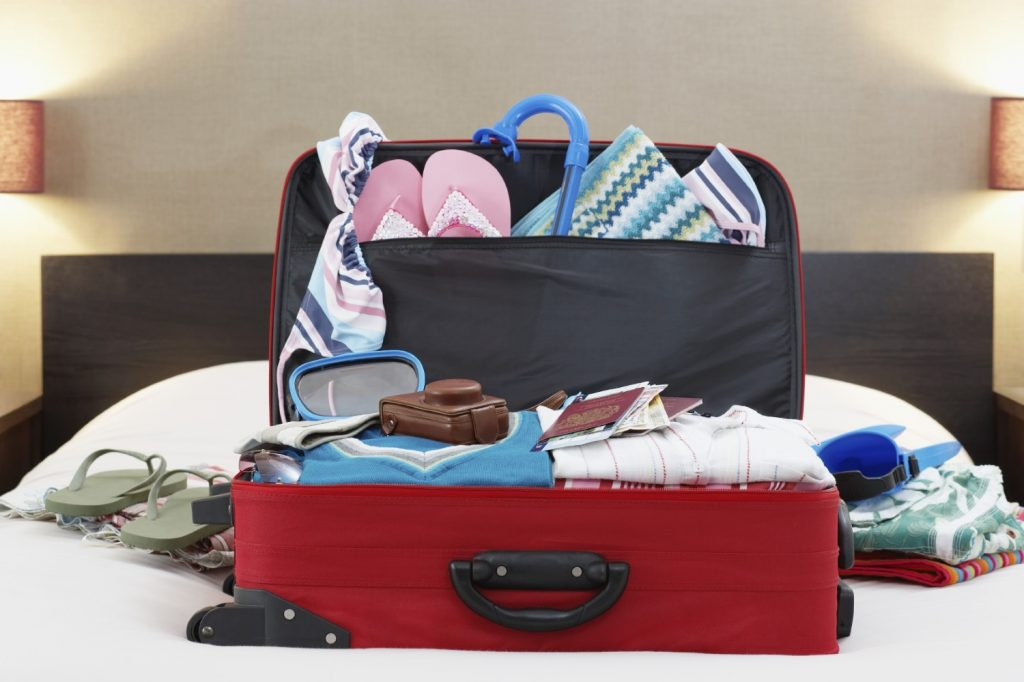 open suitcase with lighter items to weigh less
