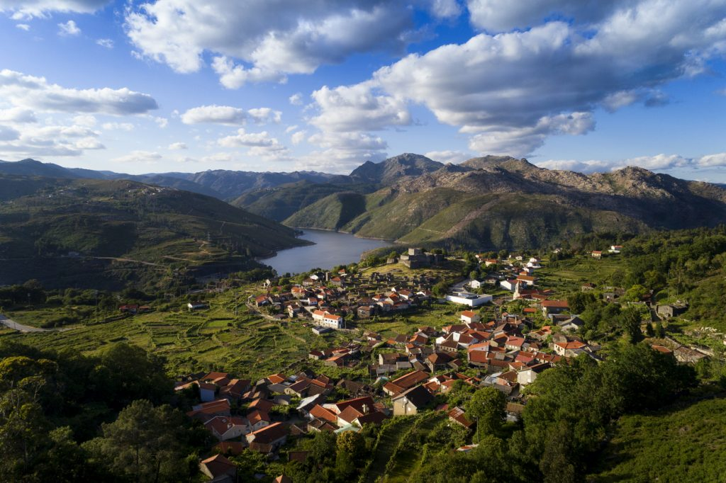 Aerial panoramic view of the historic village of Lindoso, with the surroundings mountains and lake, at the Peneda Geres National Park