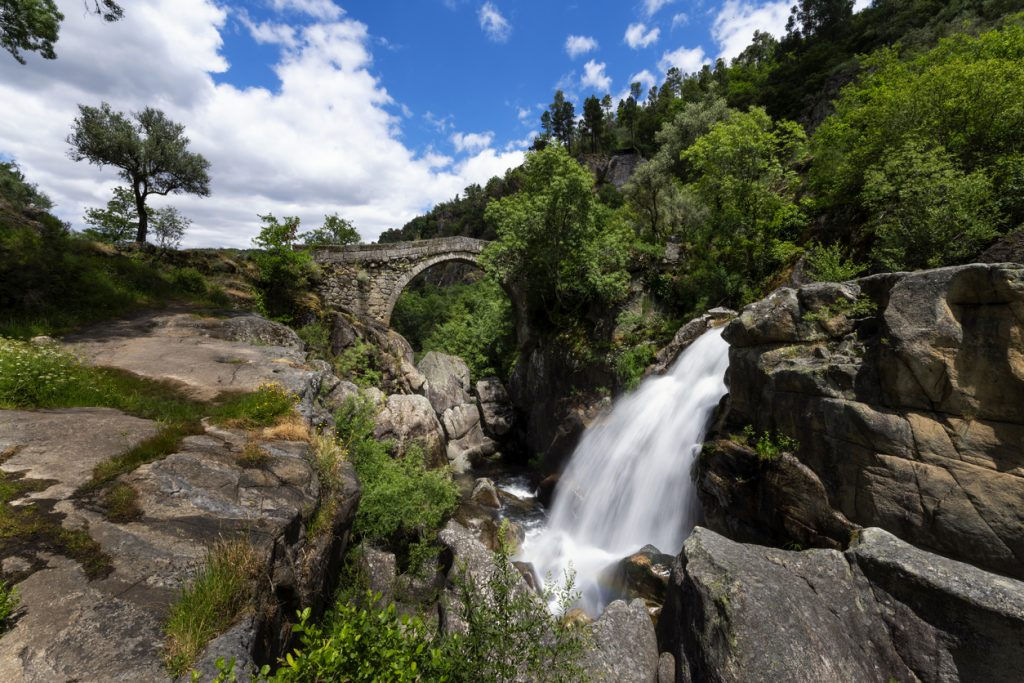View of the Mizarela Bridge with a waterfall at the Peneda Geres National Park